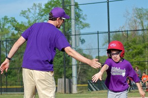 Thomas Creech coaches Little League baseball in Greenville
